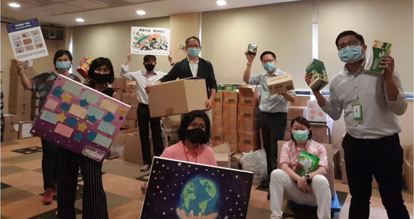 """The extended welfare team in the """"store room"""" at Work-Life Unit where some gifts were temporarily parked."""