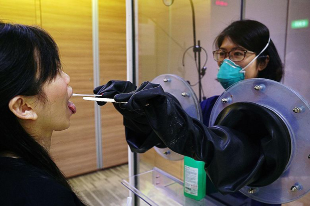 Throat swabs being done with SG Safe (above), a transparent booth system  PHOTO SGH