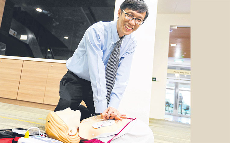 showing how to use an automated external defibrillator yesterday. He says Singapore still has some way to go in CPR training.